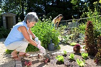 Mother and daughter 10_12 gardening, side view