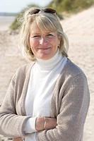 Portrait of mature woman standing on beach