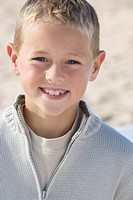 Portrait of boy standing on beach