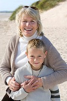 Portrait of grandmother with grandson on beach