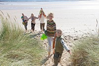 Multi_generation family running on beach