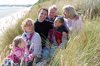 Multi_generation family sitting on beach