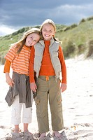Portrait of two girls standing on beach