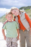 Portrait of boy and girl at beach