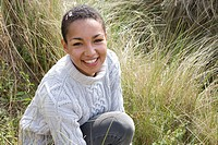 Portrait of mixed race woman in grass