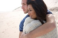 Young couple hugging at beach (thumbnail)