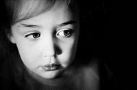 Grainy, black and white close_up of young girl