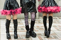 Young girls legs dressed as cosplay goths at Harajuku in central Tokyo Japan