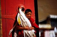 Boy lama smiling at camera, Tagong Monastery, Kangding County, Garz¨º Tibetan Autonomous Prefecture, Szechwan Province, China