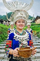 Miao young women wearing Miao traditional costume welcomes tourists with wine, Upper Langde Miao Village, Leishan County, Qiandongnan Miao and Dong Au...