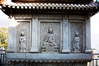 Marble screen wall carving of Buddha and disciples in Vajrasana Pagoda, Biyun Temple, Fragrant Hills, Beijing, China