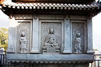 Marble screen wall carving of Buddha and disciples in Vajrasana Pagoda, Biyun Temple, Fragrant Hills, Beijing, China