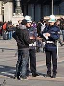 traffic policeman and traffic policewoman, piazza del duomo, milan, lombardia, italy