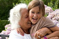 Senior woman hugging her granddaughter