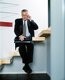 Businessman sitting on stairs