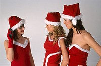 Three girls wearing christmas disguise