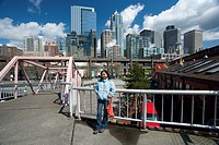 Girl posing on the waterfront in Front of Downtown  Seattle.