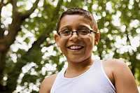 Smiling mixed race boy in eyeglasses