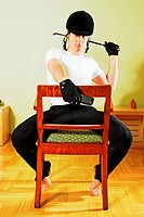 Horseman sitting on a chair
