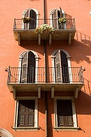 Orange house with twin windows in Venetian style, Verona, Veneto, Italy, Europe