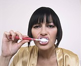 Woman brushing tooth