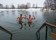 Two men bathing in lake at Ozerki natural hot springs outside Petropavlovsk-Kamchatsky in Kamchatka Russia