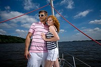 Couple resting on the sailing boat