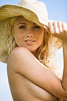 Naked young woman wearing a hat