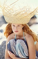 Portrait of a young woman outdoors, sunhat