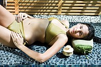 Woman lying at the poolside (thumbnail)