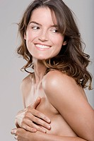 Close_up of a woman covering her breast and smiling