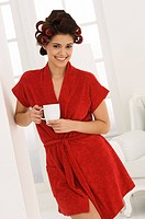 Woman holding a coffee cup and smiling
