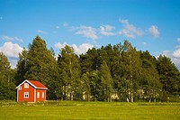 Traditional Finnish red cottage in the countyside in Pori Finland Europe