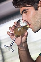 Close_up of a man drinking wine from a glass
