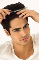 Close_up of a man combing his hair