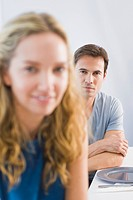 Portrait of a man and a woman sitting at a dining table (thumbnail)