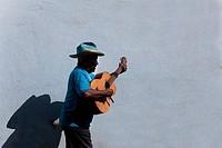 Man playing a guitar, Santiago De Cuba, Cuba