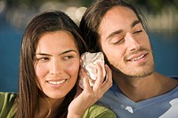Couple listening to a shell