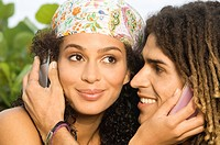 Close_up of a couple using mobile phones