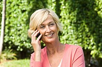 Woman talking on a mobile phone and smiling (thumbnail)