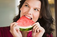Woman eating a watermelon slice