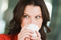 Close_up of a woman drinking tea