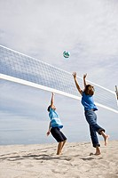 Woman with her grandson playing beach volleyball (thumbnail)