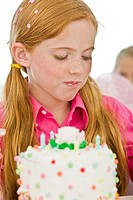 Girl eating birthday cake