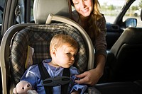 Woman with her son in a car