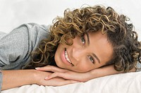 Girl lying on the bed and smiling (thumbnail)
