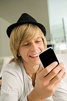 Teenage boy using a mobile phone