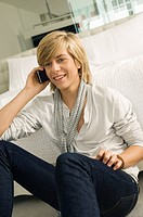 Teenage boy talking on a mobile phone