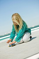 Girl playing with a remote controlled car