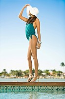 Woman standing at the poolside (thumbnail)